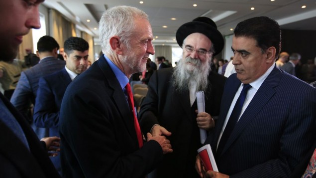 Jeremy Corbyn (left) meets with Rabbi Pinter (centre right) after delivering a speech on Labour's anti-Semitism inquiry findings