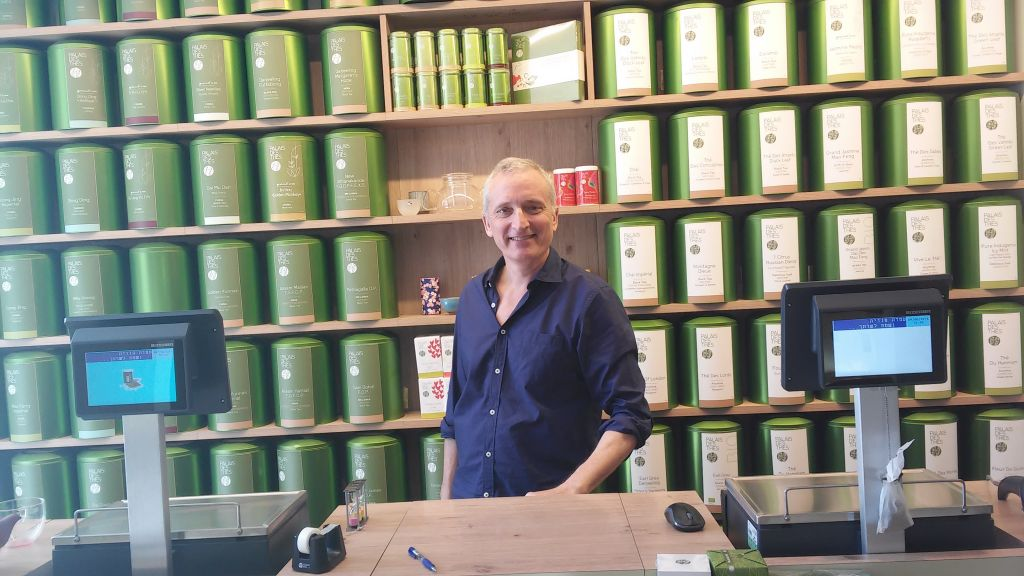 Charles Peguine in his tea shop near the site of the terror attack, June 9, 2016 (Simona Weinglass/Times of Israel)