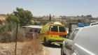 A Magen David Adom ambulance at the site where two children died after being left in a car, in the Al Kaum Regional Council in the Negev, June 22, 2016. (Magen David Adom)