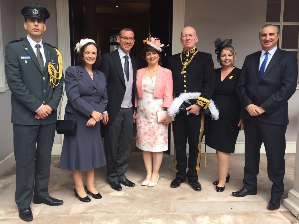 Israel's ambassador Mark Regev (center) and deputy envoy Ethan Na'eh (right) with their wives