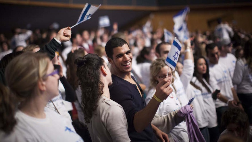 Young Jewish adults from all over the world participating in the Taglit Birthright program celebrate 10 years of the Birthright program at an event held at the International Conference Center last year in Jerusalem. (Photo by Yonatan Sindel/Flash90)