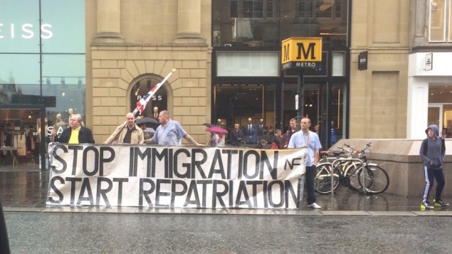 National Front demonstrators hold up a sign 'stop immigration start repatriation' following the Brexit vote.