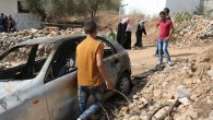 A car belonging to Palestinians that local residents said was burned by alleged Jewish settlers near the West Bank city of Ramallah, October 2, 2015. (Flash90)