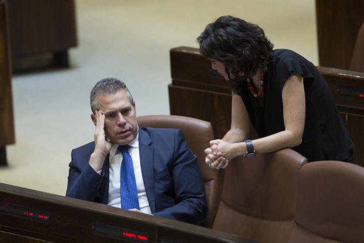 Knesset Member Tamar Zandberg speaks with Public Security Minister Gilad Erdan at the plenary session at the Knesset on June 13, 2016. (Noam Revkin-Fenton/Flash90)