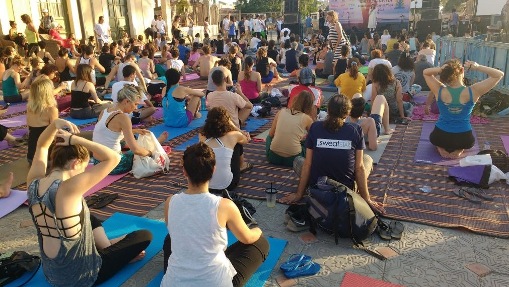 The series of movements for the yoga class for International Yoga Day on June 21, 2016 was designed by the Indian government and practiced around the world. (Melanie Lidman/Times of Israel)