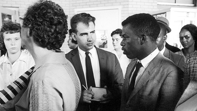 Writer Calvin Trillin, center, interviews John Lewis in Birmingham, Ala., in 1961, as the Freedom Riders were boarding the bus for Montgomery. (LIFE Images Collection)