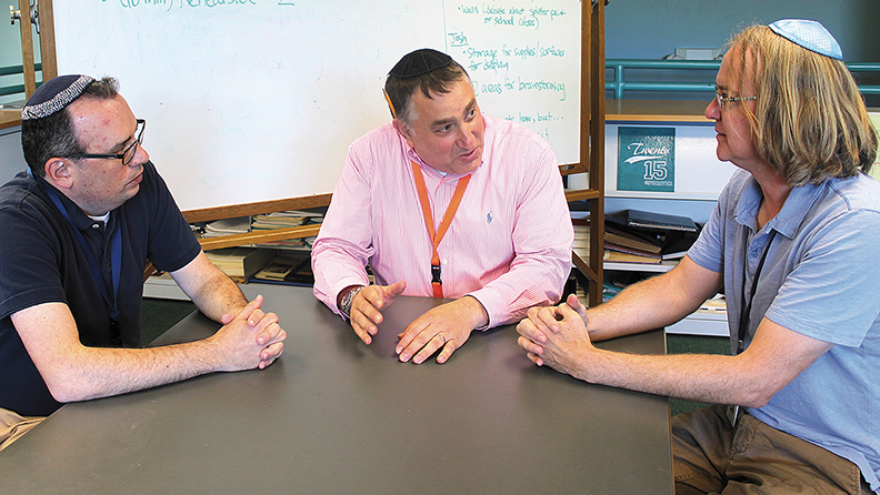 Rabbi Fred Elias and middle school teachers Jerry Shapiro and Stephen Taylor have helped the school refine its understanding of the new framework.