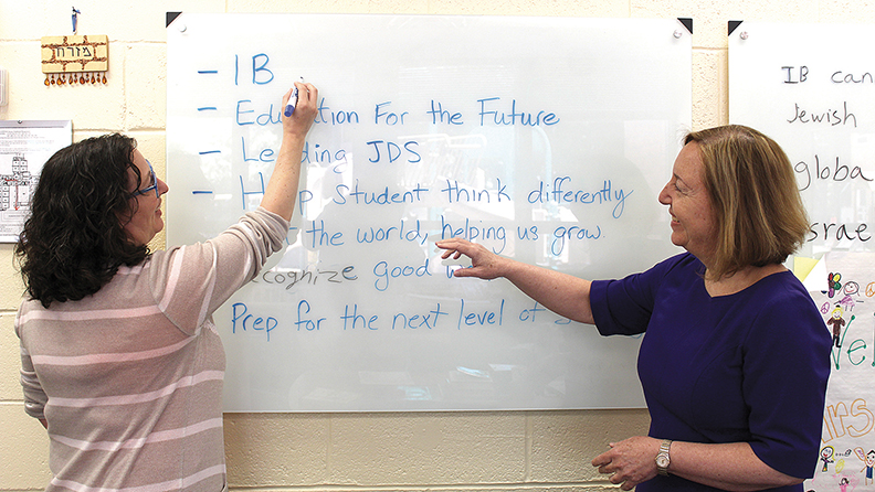 IB coordinator Ingrid Goldfein, left, and Schechter's head of school, Ruth Gafni, prepare a presentation.