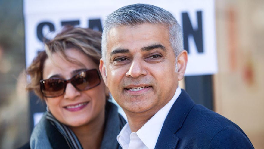 Sadiq Khan, the victorious Labour Party candidate for London mayor, and his wife Saadiya Khan, pose for photographers after voting in the elections on Thursday, May 5, 2016. (Simon Dawson/Bloomberg, via JTA)