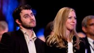 Clinton Chelsea Clinton (R) sits with her husband Marc Mezvinsky. Getty Images