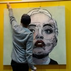 Jordan with his painting of singer Miley Cyrus