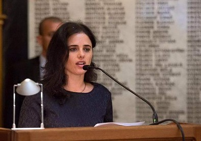 Justice Minister Ayelet Shaked at the Budapest Bar Association in front of a memorial wall carrying the names of Jewish lawyers from the city who were murdered during the Holocaust, June 6, 2016 (via Facebook)