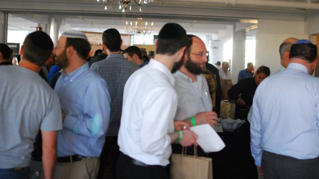 Attendees at 5th annual Whiskey Jewbilee pack Studio 450 in Manhattan. Photo courtesy of G-LO of BoozeDancing