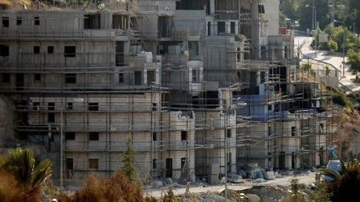 Buildings under construction in the Jewish settlement of Kiryat Arba. outside Hebron, July 6, 2016. (AFP PHOTO/HAZEM BADER)