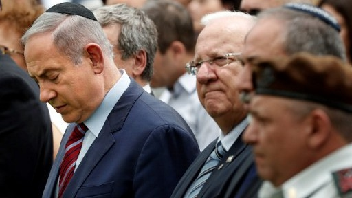 (From L to R) Prime Minister Benjamin Netanyahu, President Reuven Rivlin, Defense Minister Avigdor Lieberman and IDF Chief of Staff General Gadi Eizenkot attend an official memorial ceremony marking the tenth anniversary of the 2006 Second Lebanon War at the Mount Herzl military cemetery in Jerusalem on July 19, 2016. (AFP PHOTO/THOMAS COEX)