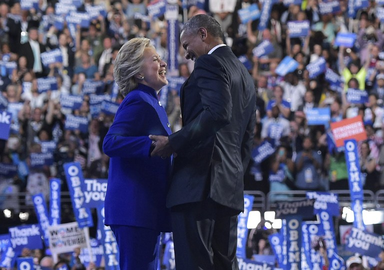 US President Barack Obama is joined by US Democratic presidential candidate Hillary Clinton after his address to the Democratic National Convention at the Wells Fargo Center in Philadelphia, Pennsylvania, July 27, 2016. (AFP PHOTO / MANDEL NGAN)