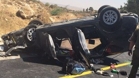 An Israeli car hit in a drive-by shooting near Hebron that killed one person and injured three on July 1, 2016. (Judea and Samaria Fire Department)