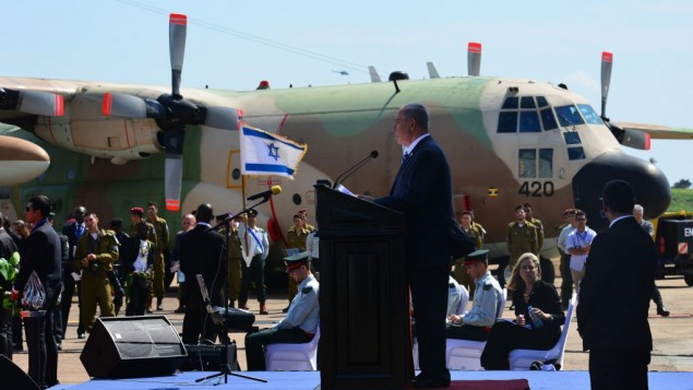 Benjamin Netanyahu speaks in front of a delegation including African leaders and ex-soldiers who took part in the the Entebbe raid 40 years ago   ( JINI Photo Agency, LTD)