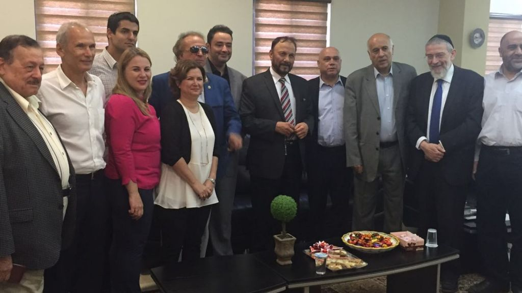 Former Saudi general Dr. Anwar Eshki (center, in striped tie) and other members of his delegation, meeting with Knesset members and others during a visit to Israel on July 22, 2016 (via Twitter)
