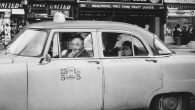 "Diane Arbus' ""Taxicab driver at the wheel with two passengers, N.Y.C."" from 1956 ©The Estate of Diane Arbus, LLC. All Rights Reserved"
