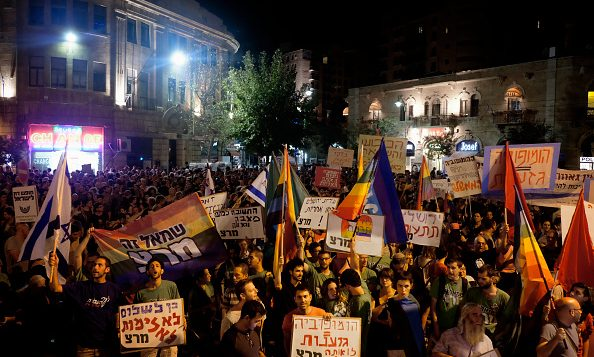 Israelis take part in a memorial rally in to protest the stabbing attack at last year's Jerusalem Pride Parade. Getty Images