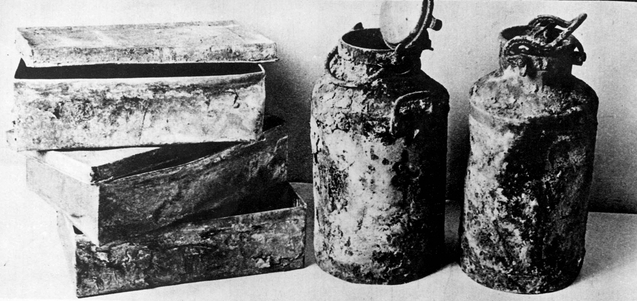 The metal boxes and milk canisters in which the 'Oneg Shabbat' archives were buried in 1942 and 1943 (public domain)