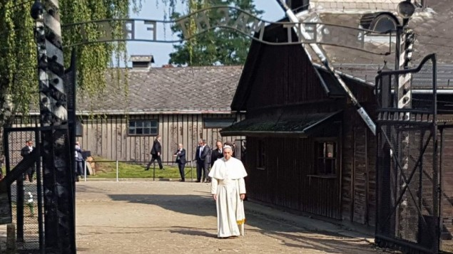 Pope Francis entering the former German Nazi Auschwitz I camp through 'Arbeit macht frei' gate.