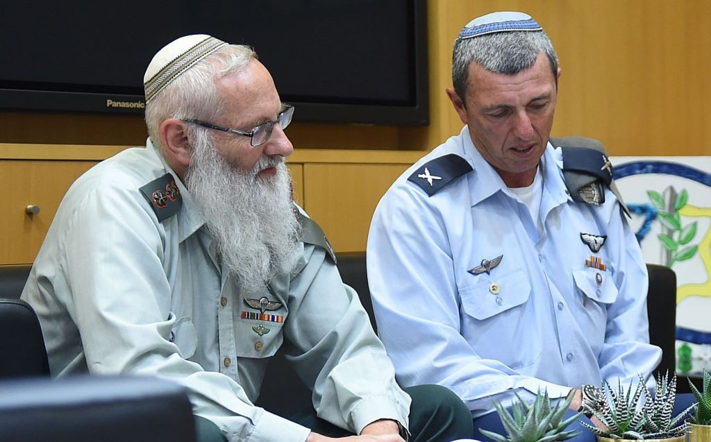 Rabbi Col. Eyal Karim, nominated to become IDF chief rabbi, sits next to his predecessor, Brig. Gen. Rafi Peretz, on April 21, 2016 (Diana Khananashvili/Defense Ministry)