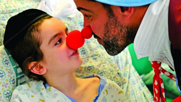 Red nose day takes on a whole new meaning for this youngster as he interacts with the medical clown ( Photos: Yaffa Judah)