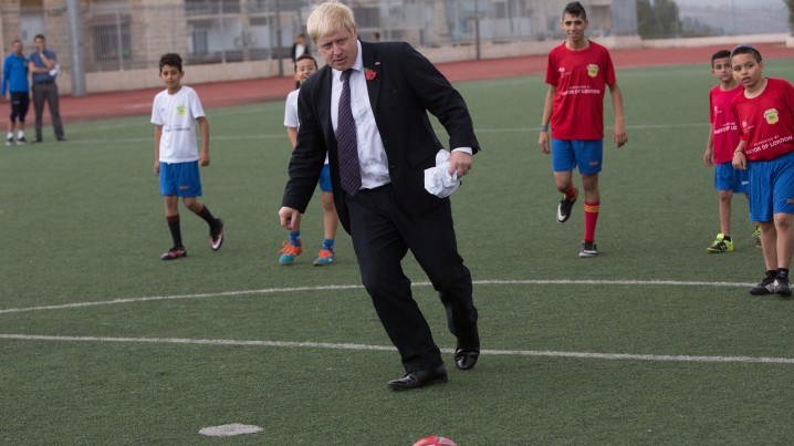 Boris Johnson kicks the ball during a ceremony and a soccer match with the'Equaliser football project a mixed soccer team of Arab and Jewish youth in Jerusalem
