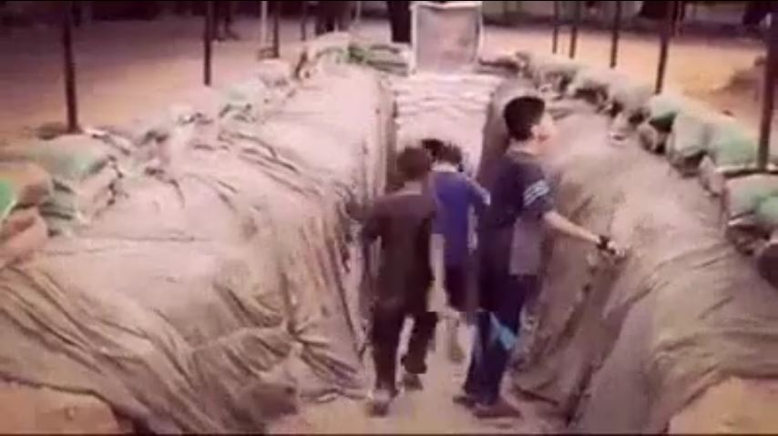 Illustrative: An image taken from a video on Hamas's Facebook page on July 20, 2016 shows Palestinian children entering into a tunnel dug by the terror group in the Gaza Strip. (Screen capture from Facebook)