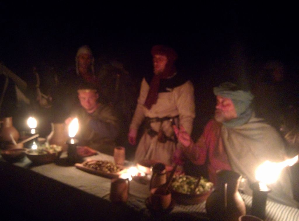 Genadiy Nizhnik (left) and his knights feast on June 30, 2016, before the reenactment of the 1187 Battle of Hattin. (Ilan Ben Zion/Times of Israel staff)