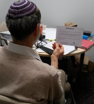 Rabbi Jonathan Wittenberg of Masorti Judaism reading an Eid Card