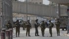 Israeli security forces at the main entrance of the Qalandiya checkpoint, a key crossing point between Jerusalem and the West Bank city of Ramallah, Wednesday, April 27, 2016. (AP Photo/Nasser Nasser)
