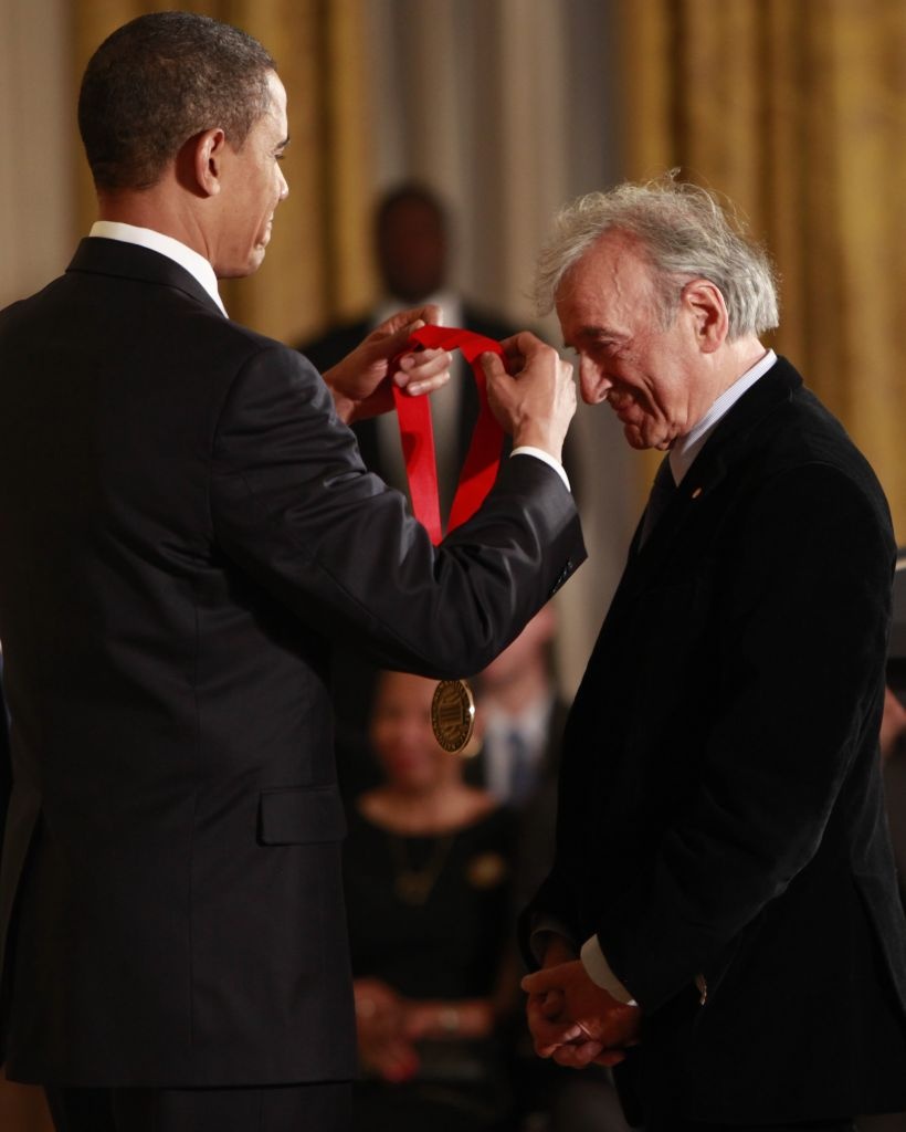 In this Feb. 25, 2009 file photo, President Barack Obama presents the 2009 National Humanities Medal to Elie Wiesel, in the East Room of the White House in Washington. Wiesel, the Nobel laureate and Holocaust survivor died Saturday, July 2, 2016. (AP Photo/Pablo Martinez Monsivais)