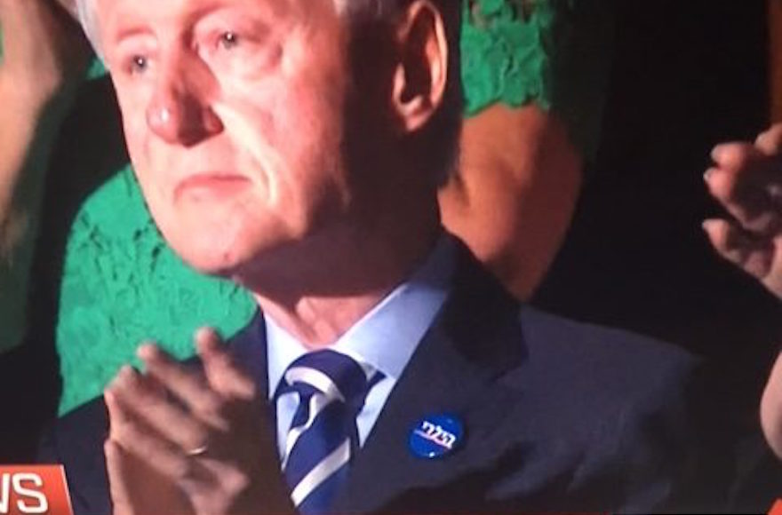 Bill Clinton sporting a Hebrew Hillary Clinton button on Wednesday July 27 2016 at the Democratic National Convention in Philadelphia. (MSNBC via JTA)