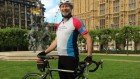 Fabian Hamilton MP outside parliament with his bike