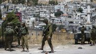 Israeli soldiers are seen at the site of a stabbing attack by a Palestinian man near the city of Hebron. Getty Images