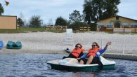 Grown-up campers ride a paddleboat at Central Florida's Camp Shalom.  Camp Shalom
