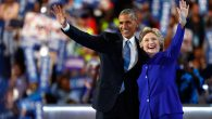 Obama and Clinton wave to the crowd on the third day of the Democratic National Convention in Philadelphia, July 27, 2016. Getty