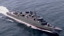 An Iranian navy vessel during a drill in the Strait of Hormuz (YouTube screenshot)