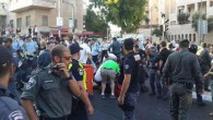 Emergency services rushed to treat the victims of the homophobic attack in Jerusalem last year