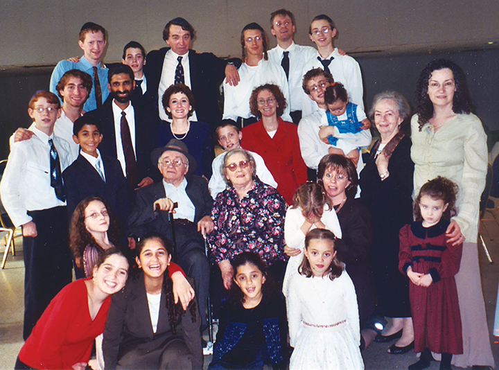 Mordkhe and Charne Schaechter are surrounded by their children and grandchildren, all of whom speak Yiddish.