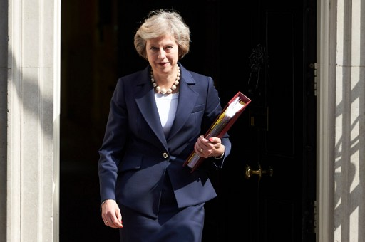 British Prime Minister Theresa May leaves 10 Downing street in London on July 20, 2016 on her way to the House of Commons to face her first session of Prime Ministers Questions. (AFP PHOTO / NIKLAS HALLE'N)