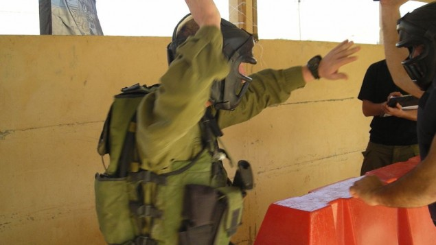 An IDF soldier sparring in full combat gear