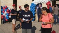 A teenage volunteer for Donald Trump campaigning outside the Republican candidate's headquarters earlier this month in Modi'in.