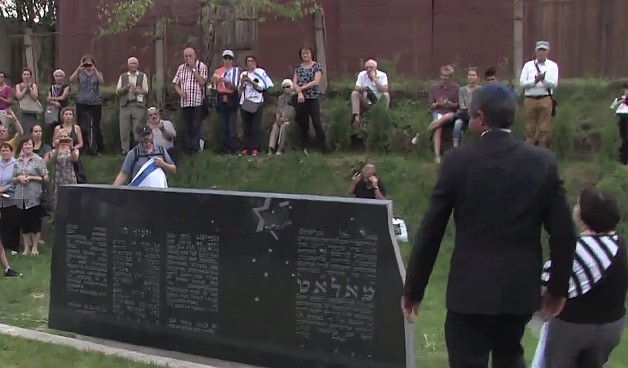 A monument for Lithuanian Jews killed in the Holocaust is unveiled in Moletai, Lithuania, August 29, 2016 (YouTube screenshot)