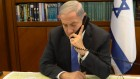 Illustrative photo of Prime Minister Benjamin Netanyahu speaking on the phone at the Prime Minister's Office in Jerusalem, April 28, 2014. (Amos Ben Gershon/GPO)
