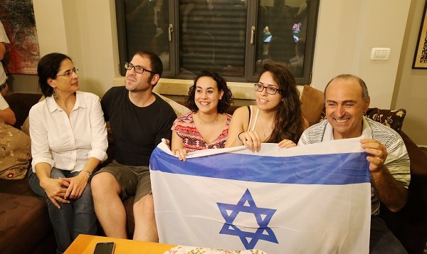 Gerbi's parents, Shmulik (left) and Nurit (right), together with family members enjoy watching Yarden's win