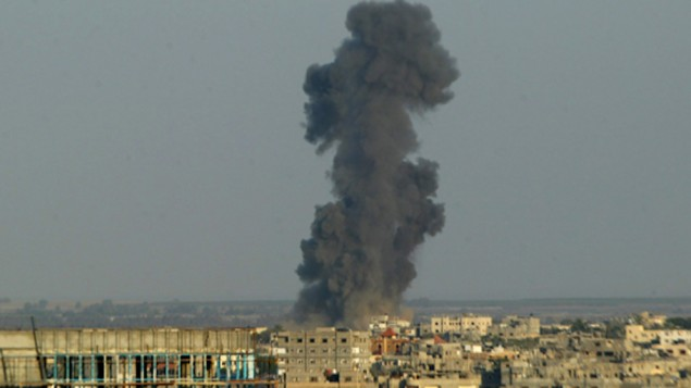 Smoke is seen after an Israeli air strike in Rafah in the southern Gaza strip, August 19, 2014.